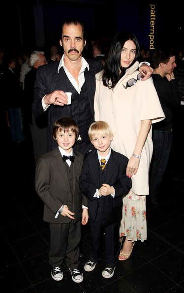 Nick Cave, looking like the coolest father ever, with wife Susie Bick and their sons... Alfred and somebodyorother, I think. I hope that sort of information isn't on the Official Fangirl Test, because I just don't care that much.