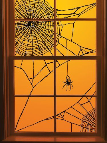 DIY Halloween Spiderweb Window Decoration ~ It's just black yarn, scotch tape...  brilliant idea.