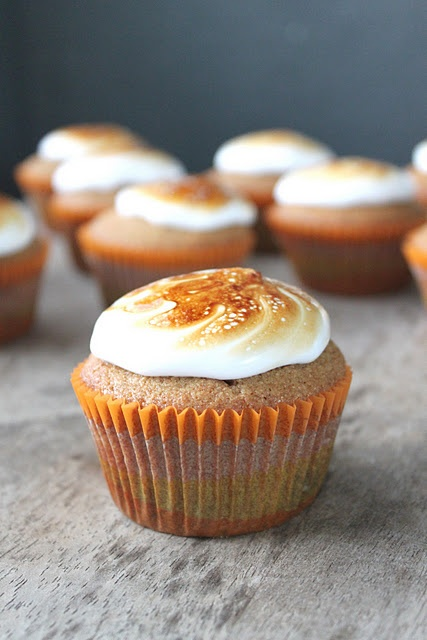 S'mores cupcakes.  Graham cake with melted chocolate chips inside & marshmallow frosting!