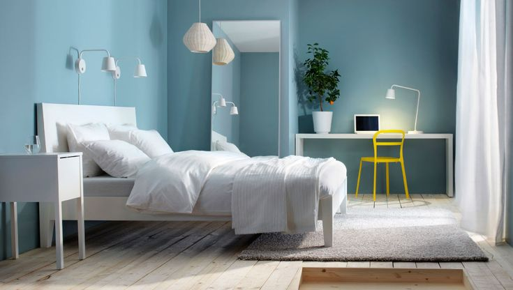 Minimalist bedroom in a small space - LOVE that wall colour! I'll have to find out the exact name of that ppaint colour.