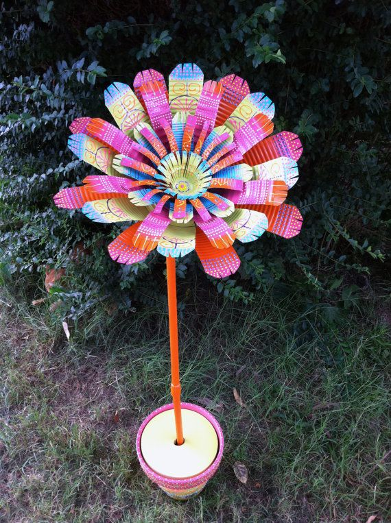191 best can projects recycled stuff images on pinterest for Garden art to make