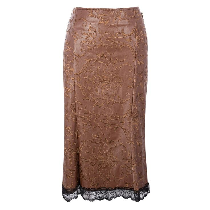 Brown Steampunk Skirt  A unique take on Steampunk fashion, this brown mid length skirt features intricate details such as the leather strap and brass buckle tailored on the right hip and delicate lace trim on the hem of the skirt. A delicate ornamental print runs across the fabric of this skirt. Reinvent your personal style with a little Steampunk for an edgy out of this world look.
