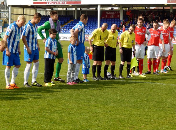 Oliver lined up on the pitch next to the officials and team captain