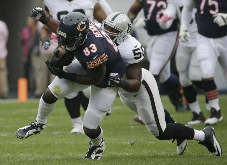 Oakland Raiders middle linebacker Curtis Lofton (50) tackles after Chicago Bears tight end Martellus Bennett (83) catches a pass during the first half of an NFL football game, Sunday, Oct. 4, 2015, in Chicago. (AP Photo/Nam Y. Huh)