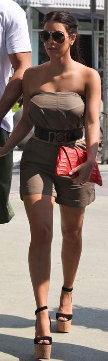 Kim Kardashian wearing Porsche P'8433A Classic Aviator Style Sunglasses Burberry Twist-fastening leather belt Christian Louboutin Super Dombasle Juliette Jake's Red Hot Exotic Clutch Tiffany Co. diamond stud earrings. Kim Kardashian Shopping For New Dash Locations In Miami May 13 2011.