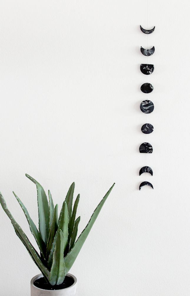 Avoid the Super Bowl + follow this DIY to make wall art inspired by the different phases of the moon.