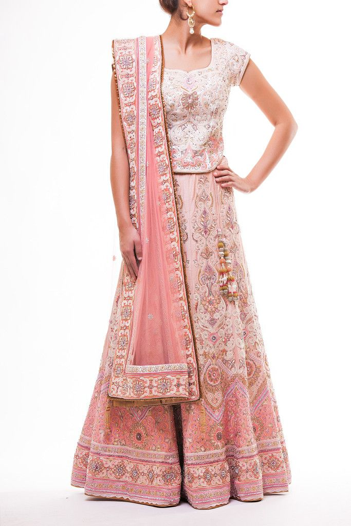 Very Elegant Peach Pearl and Resham Work Lehenga paired with off white Dupion Silk Choli fully embroidered with Resham work and highlighted with pearl and peach crystals.