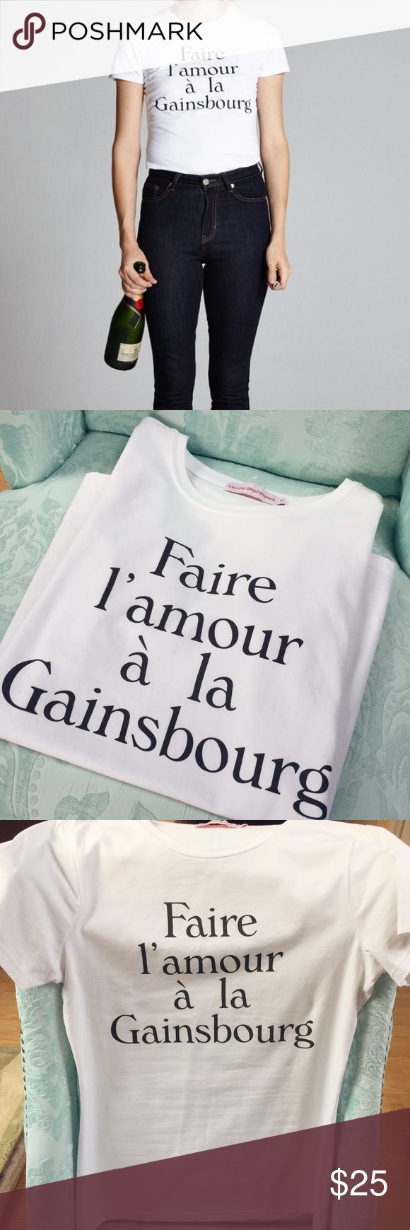 """Faire L'amour à la Gainsbourg White Tee Cheeky T-shirt from L'Ecole des Femmes...slogan means """"Make Love Like Gainsbourg"""". Never worn but missing tags. Size M, 95% cotton and 5% Lycra. I am typically an XS or S but sized up for a bit looser fit as this is intended to be fitted. Bundle 2 or more items to save 20%! L'Ecole des Femmes Tops Tees - Short Sleeve"""