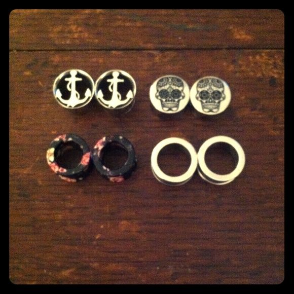 "1/2"" 1/2 Inch Plugs Gauges Skull Anchor Floral I have a lot of four 1/2"" plugs all from Hot Topic.. There's a silver nautical anchor pair ⚓️, silver sugar skull pair , black and pink floral rose patterned pair and a regular silver pair! I will sell them as a bundle for $24 or $8 each! Hot Topic Jewelry Earrings"