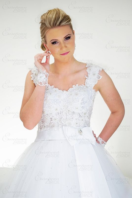 WWW.EUROPEANBRIDE.CA |  Genevive - Charming and Playful. Flower crystal beaded corset with a bouffant skirt. A satin bow with pear shaped Swarovski crystal adds charm and playfulness.   #torontoweddings #wedding #weddingdress #weddinggown #bride #bridaldress #bridalgown
