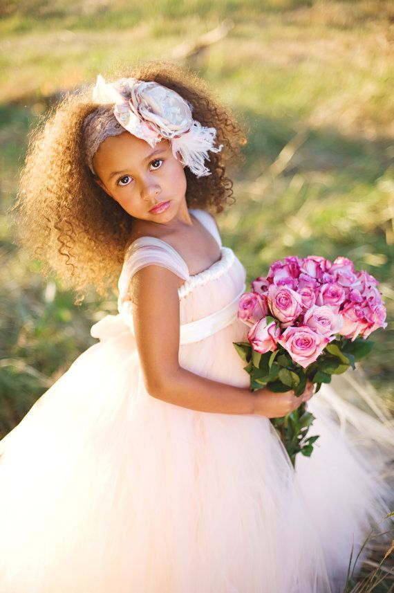"This gorgeous dress is a classic. Made with a combo of light pink and champagne tulle, we've created the perfect shade of ""blush"". It has ivory ribbon accents and sweet tulle cap sleeves for a very soft look. Satin ribbon sash ties into a luxe bow in back. Perfect for your flower girl! *Please note: […]"