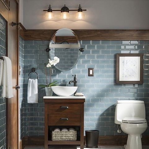 Loving how this simple bathroom vanity light by @progressltg makes a big impression on the adorable bathroom. Lighting at its best.
