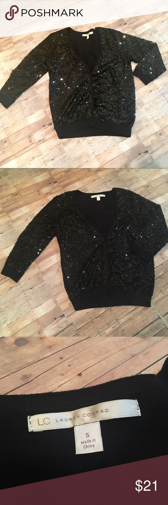 "LC Lauren Conrad Black Sequin Cardigan. LC Lauren Conrad Black sparkly sequin cardigan. In excellent condition. Snap close sweater. Size is women's small.  Body length: 20-21"" Chest: 14-15"" LC Lauren Conrad Sweaters Cardigans"