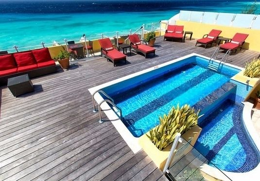 Live the suite life on the dazzling turqoise shorefront of Barbados, near St Lawrence Gap, including all travel and breakfast