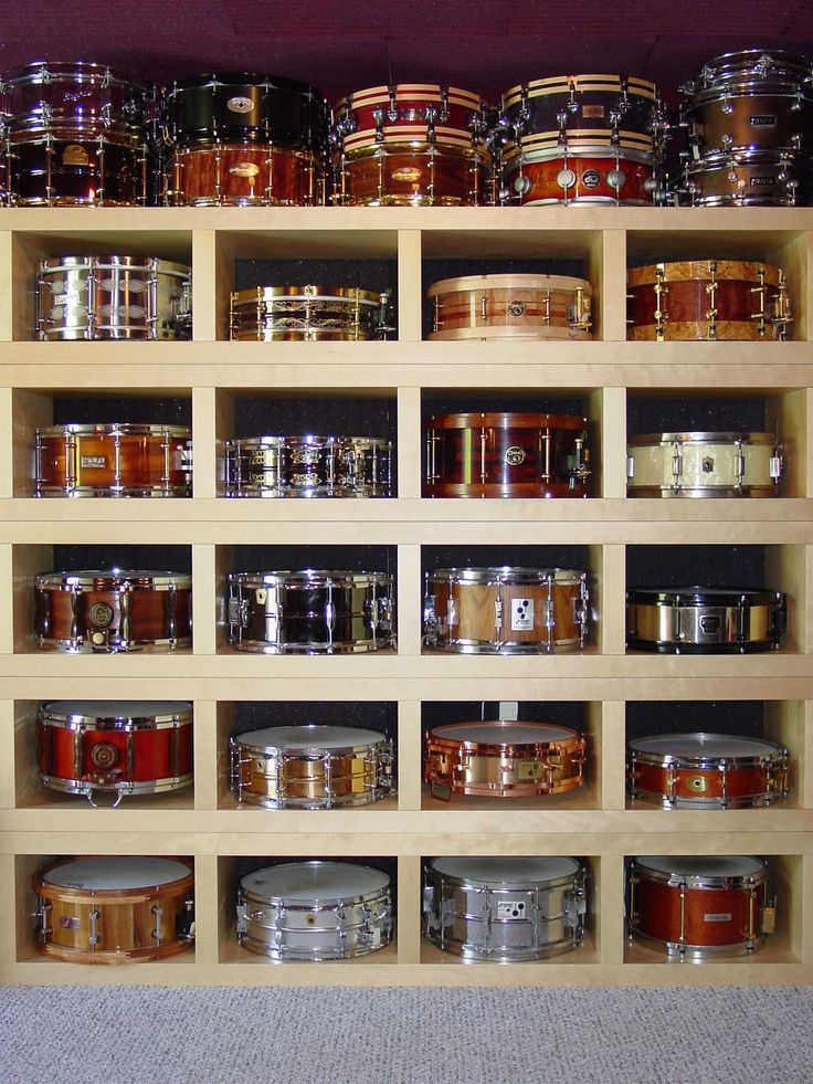 Awesome drum shelf right here. I want a room that looks like this lol