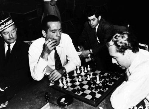 Humphrey Bogart & Paul Henreid playing chess on the set of Casablanca.