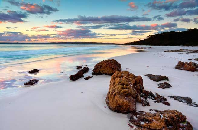 HYAMS BEACH Where: Jervis Bay, Australia Of all the beautiful beaches on Australia's coast, only Hyams Beach holds the Guinness Book of World Records title of the whitest sand. Crystal-clear water, forests, and wetlands only add to Jervis Bay's appeal. Inhabited by Aboriginals for thousands of years, the area boasts important archeological sites, like rock art, stone artifacts, and axe grinding grooves.
