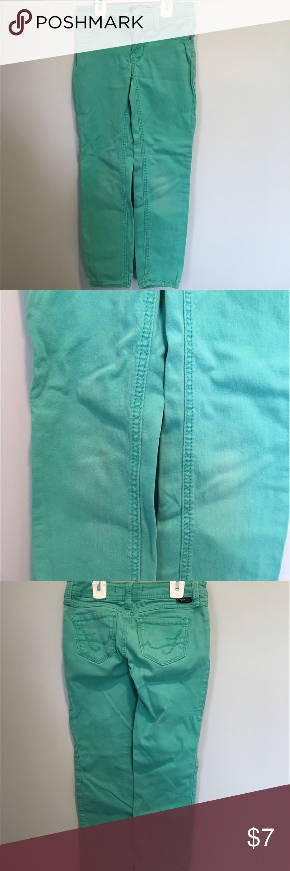 Teal skinny jeans These teal girls skinny jeans are in great condition. The knees are slightly faded but no other holes or stains. Fragile Bottoms Jeans