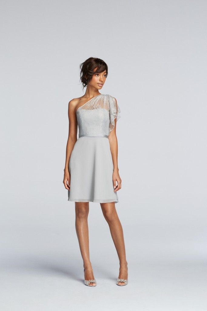 This short shift bridesmaid dress is stunning in soft grey, with a silk belt and lace draped delicately over one shoulder. The subtle detail and design of this piece gives a mature and luxurious look.