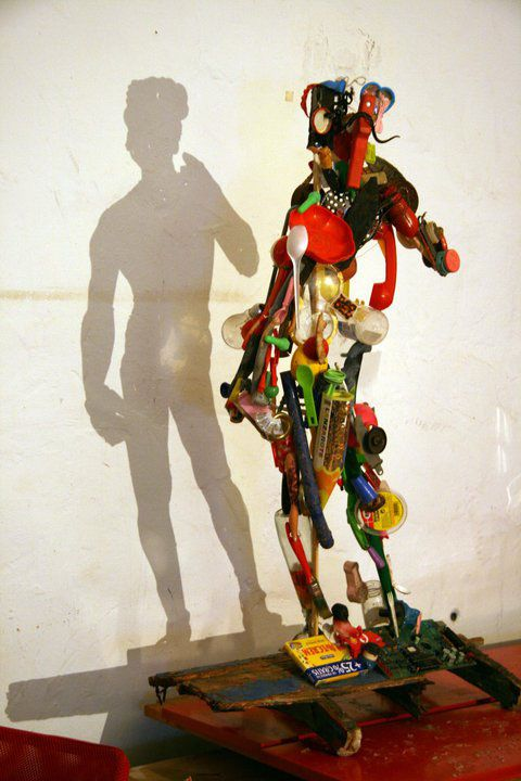 A shadow statue made from trash! I can't imagine how the artist visualized this. Very fun.....