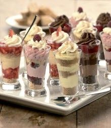 little parfait desserts in shot glasses. Cheesecake, chocolate mousse, strawberry shortcake? Easy to make ahead of time and easy to grab at the table. come to mama.