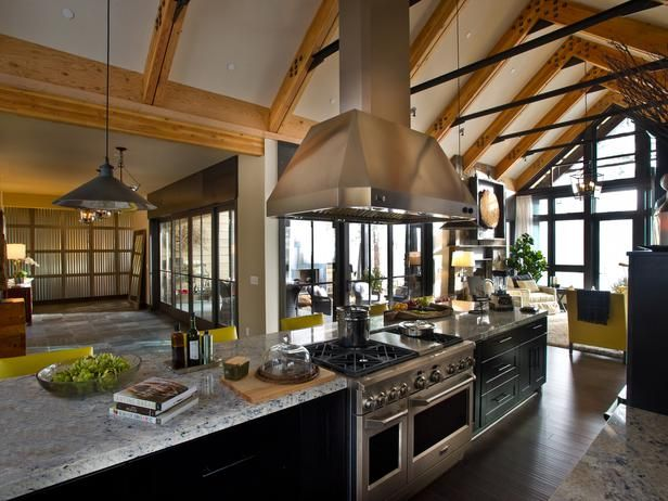 Kitchen toward foyer-alt. An open space flanked by walls of glass and visually defined by exposed trusses, the kitchen provides space to both prepare meals and gather with friends.
