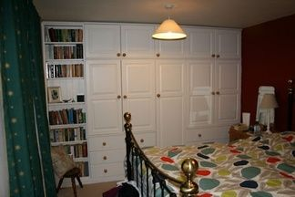 Fitted wardrobe with bookcase.