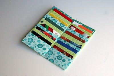 loyalty card storage ideas.  this one has a link to the tutorial on how to make a fabric card holder.