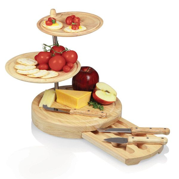"""The Regalio is an original design by Picnic Time. It is a three-tiered combination serving tray and cheese board with three cheese tools and two serving plates. Measuring 10"""" x 10"""" x 11.5"""", it's made of eco-friendly rubberwood, a hardwood that's known for its durability and beautiful grain. The two serving trays sit atop the cheese board base and swivel from side to side so you can create the most fitting and attractive food arrangement."""