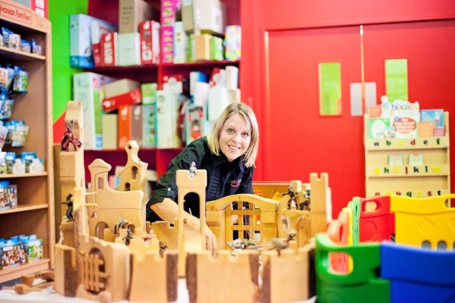 Our Chief Poobah getting upclose with some of Kinderkram's German-crafted wooden castle pieces #entropy #woodentoys
