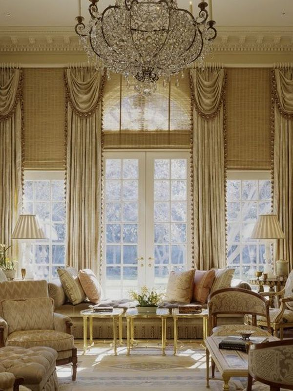 5 Tall Window Treatment Ideas - are the 2 side windows shorter?  If so, this looks like a grander version of Chris' bedroom windows - hung hem all from the ceiling...