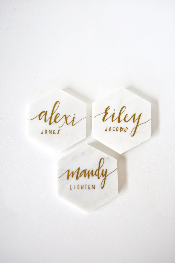 Beautiful White Marble Tile Place Cards with Calligraphy || perfect as unique wedding decor, dinner party name tags, birthdays, anniversaries, gifts, favors and more. * Please do not purchase this listing > message us for a listing custom for you! * ABOUT This listing is for a set of natural white marble hexagon shaped place cards hand written in calligraphy pen. COLORS Our polished marble tiles come in a beautiful natural white and grey veined color. Calligraphy comes in gold, copper, o...