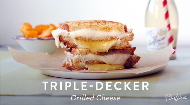 Triple-Decker Grilled Cheese  Ingredients: 6 slices sourdough bread 4 tablespoons salted butter, softened 2 ounces goat cheese 4 ounces sharp cheddar 4 ounces fresh mozzarella