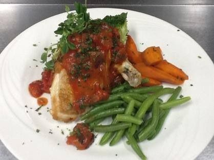 Chicken supreme stuffed with crab meat, tomato and capsicum salsa
