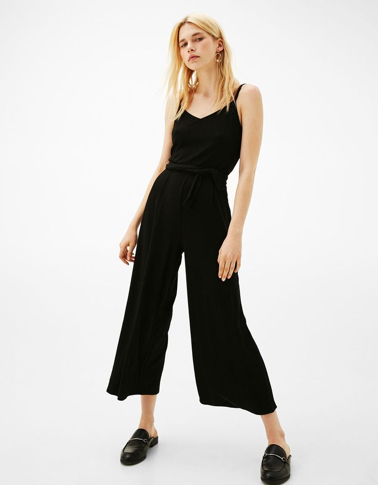 Long strappy jumpsuit with belt. Discover this and many more items in Bershka with new products every week