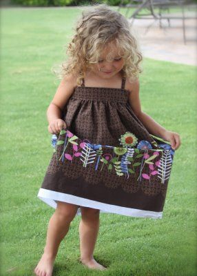 Super cute sundress....maybe a little shorter for Leah. Wider chest band? So many directions I could take this one.