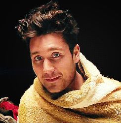 Dan Smith of Bastille featuring a blanket on the set of Things We Lost in the Fire