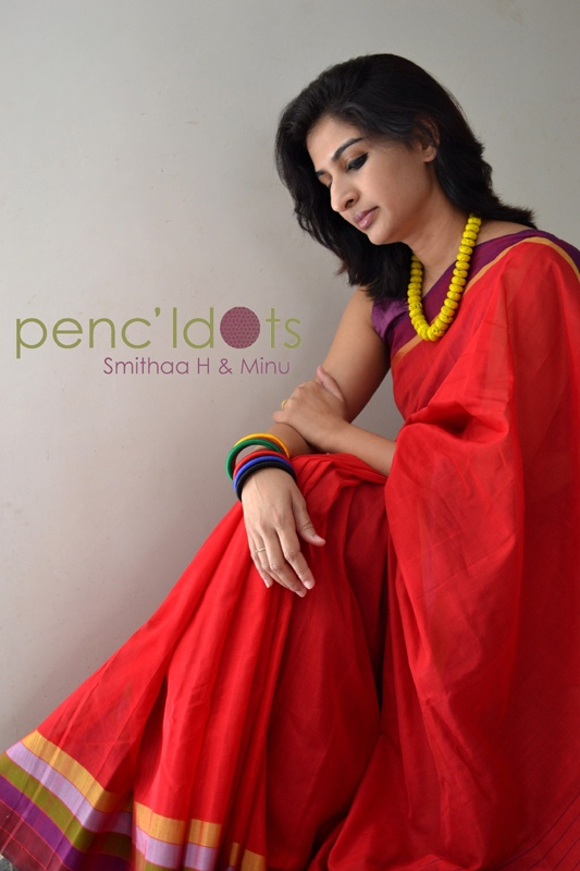 Handwoven Silk Cotton Sari with multi-color stripes border and delicate stripes on the pallu. #Holi #Red