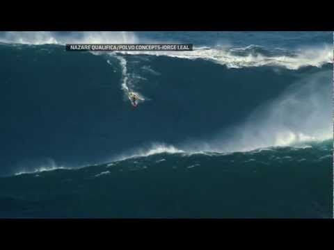 Surfin' a 90-foot wave off the coast of Portugal: Garrett McNamara breaks the world record for the largest wave ever surfed.