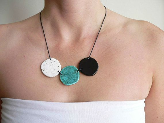 This one of a kind ceramic statement necklace in turquoise, black and white is easy to combine to a variety of outfits and would therefore make an