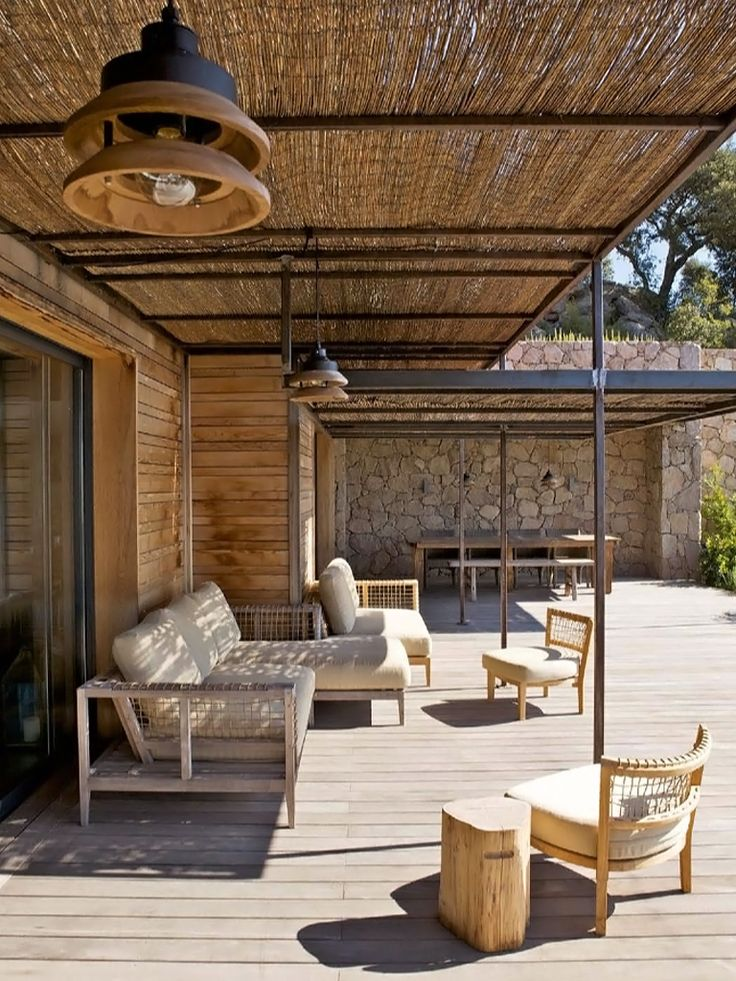 Great size deck. Love the stone wall and timber panelling