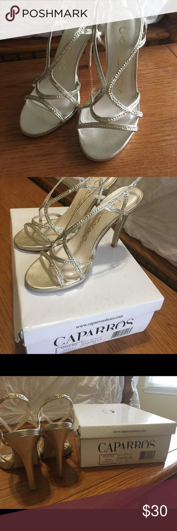 Caparros Gold Heels Bought for my wedding, but never wore them. Size 7, excellent condition. About a 4 in./4 1/2 in. heel. Stretchy strap at heel. Great for a wedding or formal party! Caparros Shoes Heels