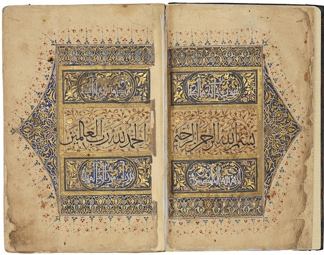 The opening spread of this Koran is richly illuminated, with the first two lines of the surah al-Fatihah (the Opening). Iran, probably Shiraz. 1336-1354 A.D. 21.9 x 14.3 cm. Thuluth, naskh and kufic scripts. Courtesy of the Nasser D Khalili Collection of Islamic Art.