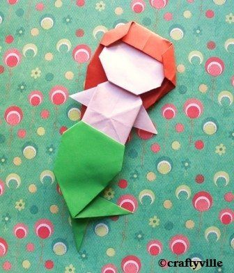 origami mermaid - instructions here:  http://kids.kewpie.co.jp/download/origami/kewpiekids_origami_2008_11_2.pdf