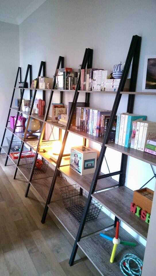 Incredible use of the industrial ladder shelves