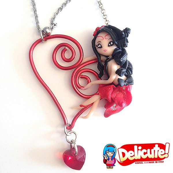 Wirabolas are romantic fairies hanged on an artistic wire charm, dangling on the chain of the necklace. These jewels are completely handmade, 100% Made in Italy with high quality materials. The pendant in artistic wire is made of anodized aluminum, modeled by hand. Find it on www.Delicute.com
