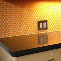 Orange Circle Tile backsplash kitchen - Clayhaus Ceramics