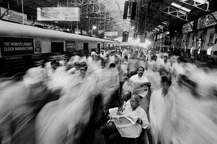 Raghu Rai.  Local commuters at Church Gate railway station. Mumbai. 1995.