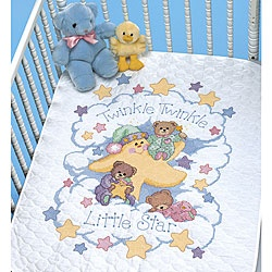 """Give your precious baby a star to wish on every night with this """"Twinkle Twinkle"""" stamped cross stitch quilt kit. The baby blanket kit comes with a white quilt, cotton embroidery thread and needle as"""