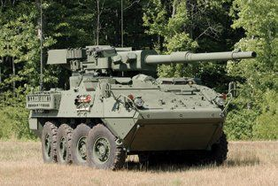"""General Dynamics Land Systems, Stryker MGS, AKA M1128: """"MGS"""" stands for """"mobile gun system,"""" aptly named because one of this eight-wheeler's three-man crew has a finger on the trigger of a 105-mm autoloading cannon that is not that different from the original armament of the M1 Abrams tank. And he can fire one of those monster shells every six seconds. A 7.62-mm machine gun and a 50-caliber machine gun handle less fortified threats. The Stryker is capable of 60 mph and shooting on the move."""